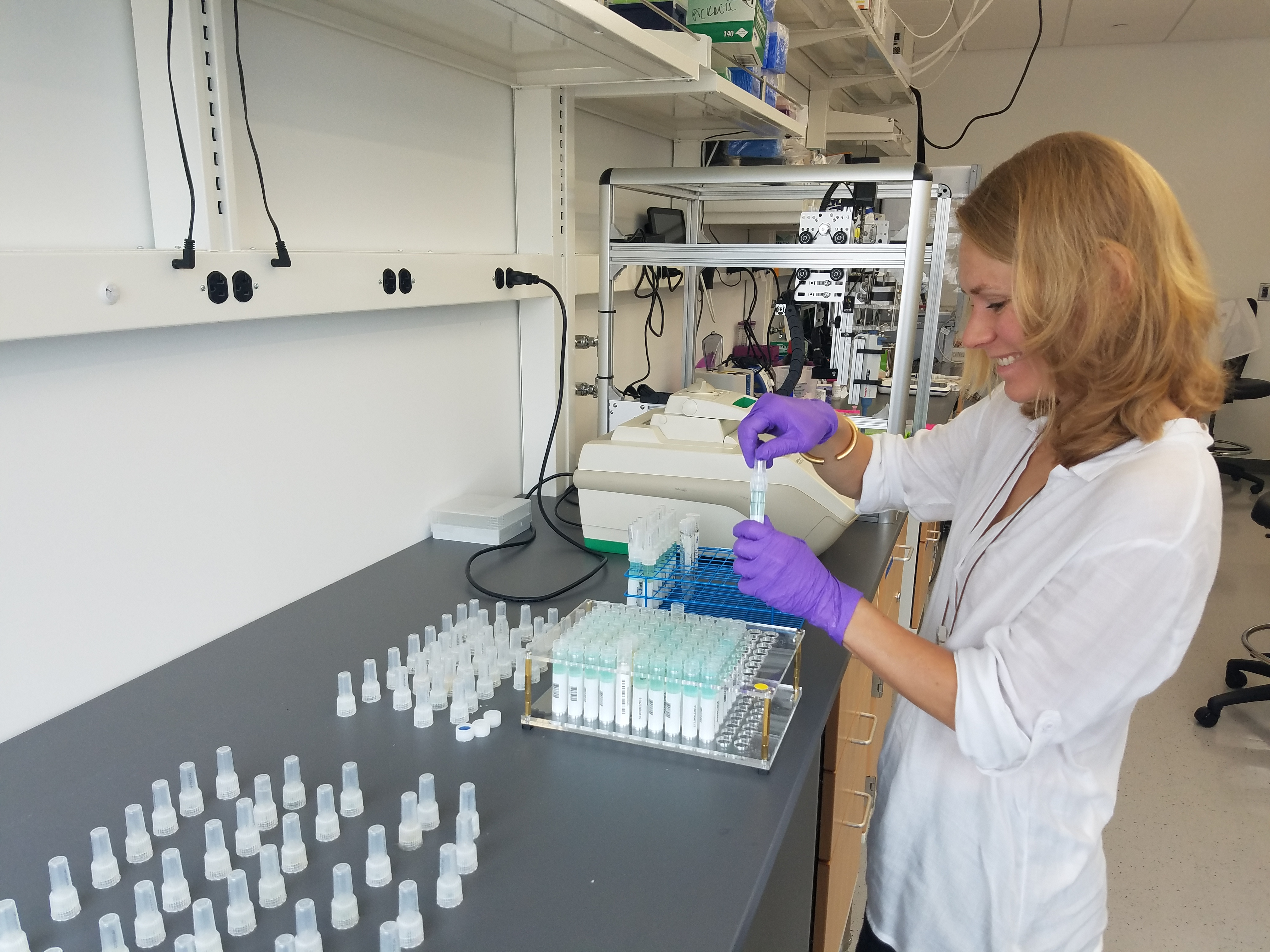 Kaja prepping saliva samples that customers send in to be processed on the OT-One S